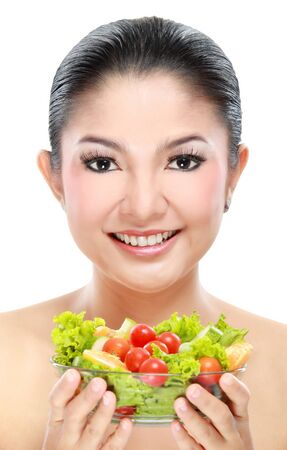 Closeup portrait of an beautiful asian young woman with a bowl of salad photo