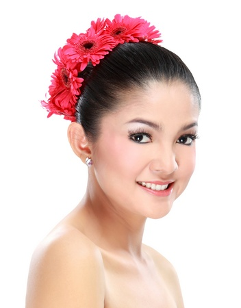 indonesian: Portrait of young beautiful asian woman with flower ornament on her hair