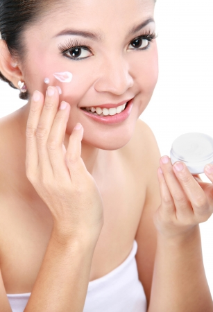 woman face cream: Beautiful women applying moisturizer cosmetic cream on face