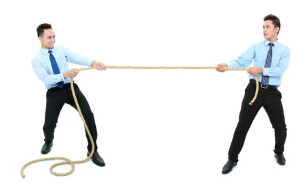competition concept. two businessman pull the rope to different side photo