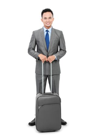 full body portrait asian young business man with suitcase isolated on white background photo