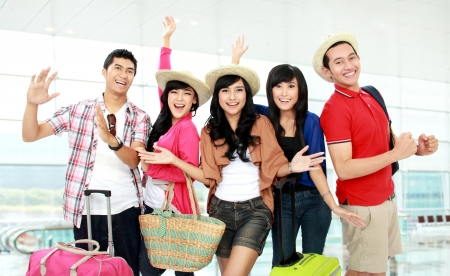 Happy group of tourists looking to camera and smile Stock Photo - 16827328