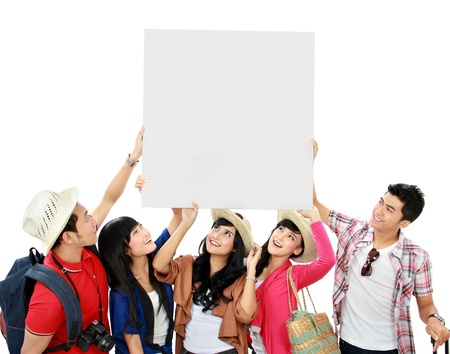 group of young tourist hold a white banner and look up photo