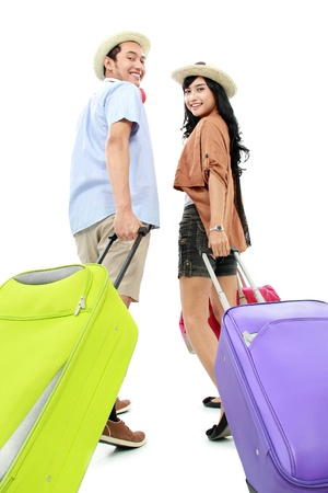 portrait of Happy friends going on vacation walking with suitcase and smile Stock Photo - 16827317