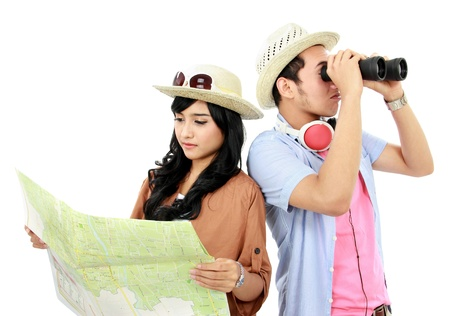 Happy teenagers tourist one look at map and each other seen with binoculars Stock Photo - 16827322