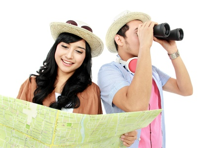 Happy teenagers tourist one look at map and each other seen with binoculars Stock Photo - 16827332