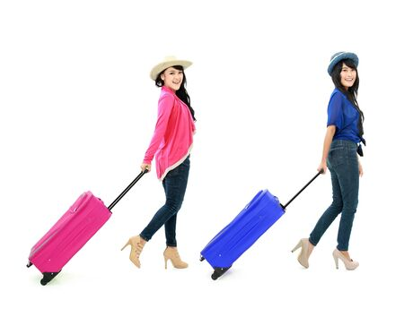 portrait of Happy girls going on vacation walking with suitcase and smile Stock Photo - 16827313