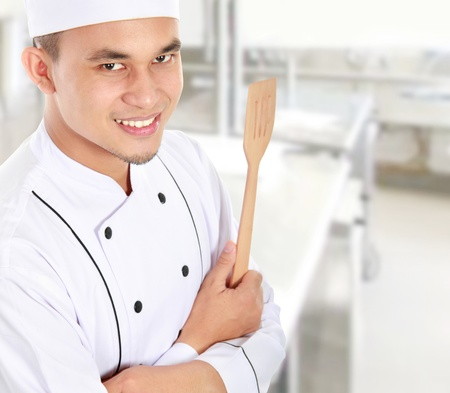 asian chef: Portrait of confident male chef smiling in the kitchen