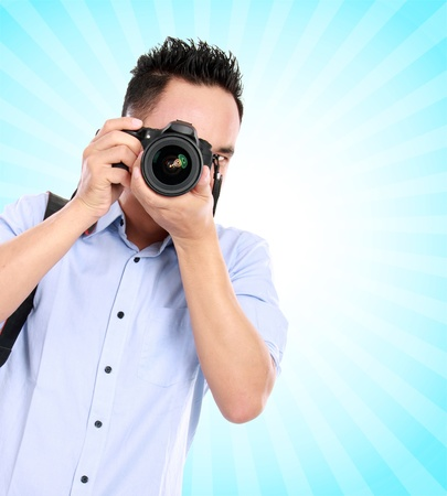 portrait of asian professional photographer ready to take some photo on blue background Stock Photo - 16800521