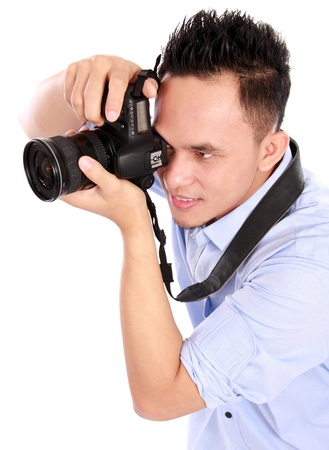 portrait of man using camera ready to take photo