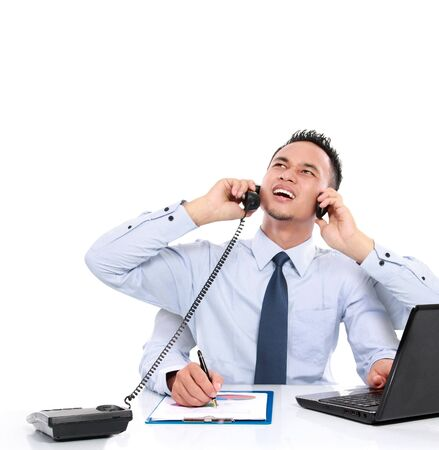 potrait of busy business man while working, multitasking concept Stock Photo - 16800505