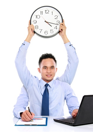 multitask: dateline concept of man holding clock while working