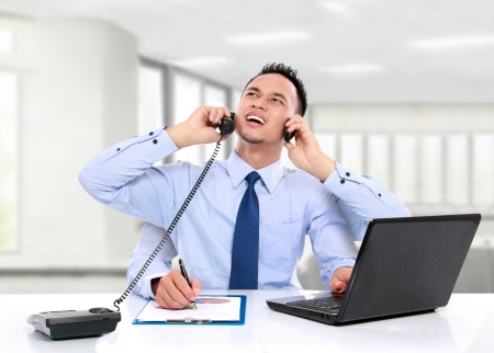 tasks: potrait of busy business man while working, multitasking concept