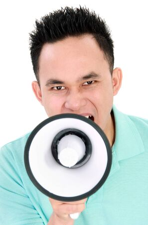 making an announcement: Portrait of a handsome young man making announcement over a megaphone isolated on white background Stock Photo