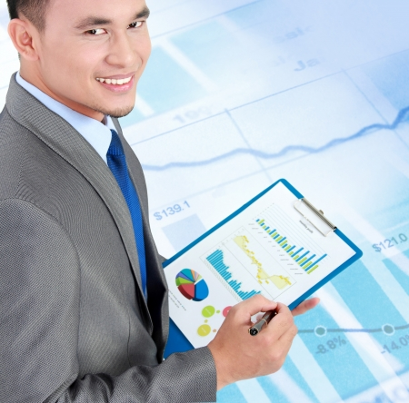 happy business man with financial report photo