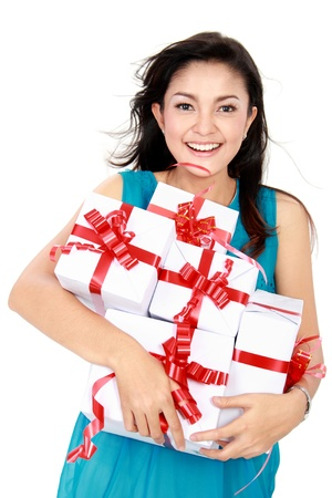 happy woman carrying gift box isolated over white background Stock Photo - 16800543
