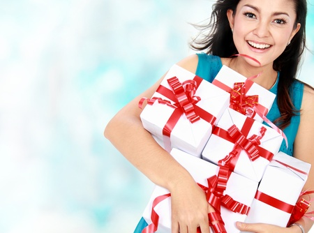 happy woman holding present in her hand photo