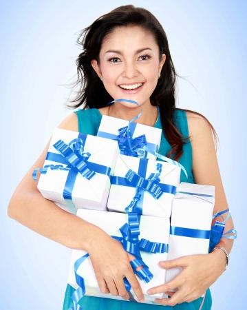happy woman with many gift box in her hand photo