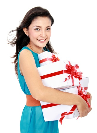 happy woman carrying gift box isolated over white background Stock Photo - 16800567