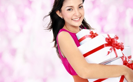 happy attractive woman carrying gift box Stock Photo - 16800561