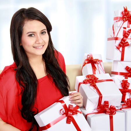 happy woman with red sitting with many gift box Stock Photo - 16800584