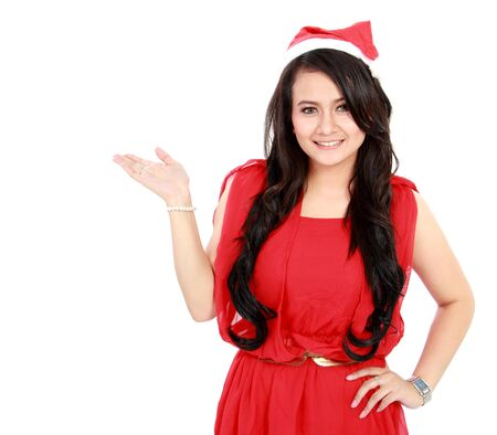 young woman with santa hat showing blank space on white background