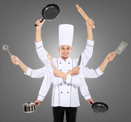 frying: Busy chef concept with many hand on grey background Stock Photo