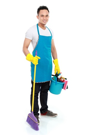 bright housekeeping: portrait of man with cleaning equipment isolated over white background Stock Photo