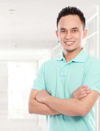 portrait of smiling young asian man in campus Stock Photo - 16800520