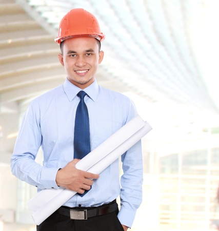 asian architect: confident Handsome young asian man architect in building construction Stock Photo