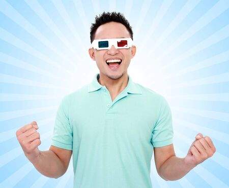 happy man with 3d movie glasses celebrating new movie on blue background photo