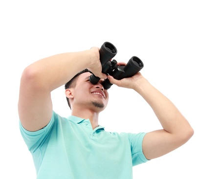 Portrait Of A Young Man Using Binocular Over A White Background photo