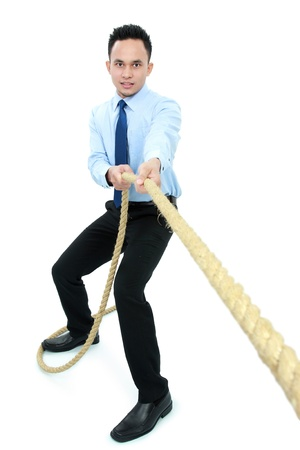 male executive man pulling a rope isolated against white background Stock Photo - 16800508