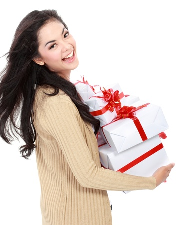 Beautiful girl with gift box isolated over white background photo