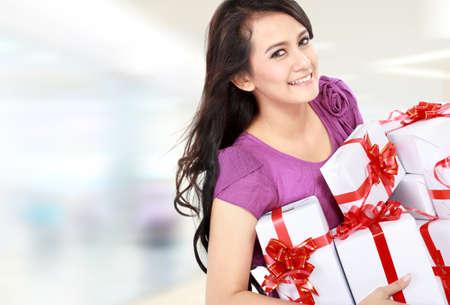 smiling happy woman carrying gift box at the shopping mall Stock Photo - 16800583