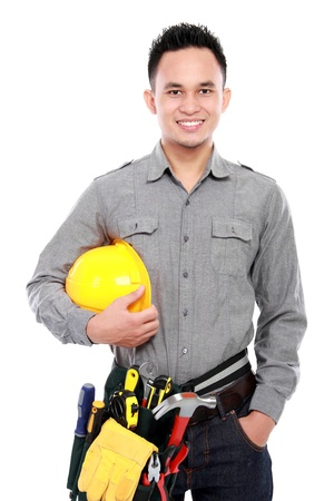 smiling worker with full equipment ready to work Stock Photo