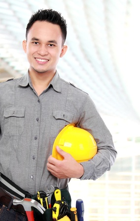 smiling worker with full equipment ready to work Stock Photo - 16958722