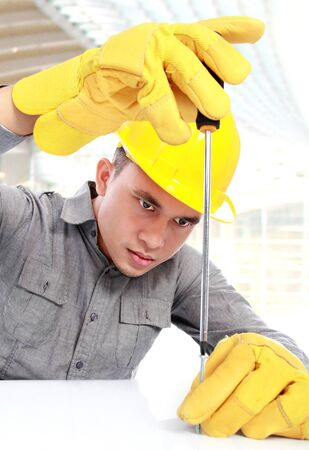 young worker installing screws with screwdriver Stock Photo - 16958711