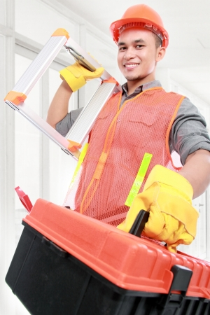 industrial worker bring ladder and  equipment ready to work Stock Photo - 16958723
