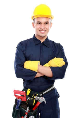 asian architect: worker use blue uniform crossed his arms and belt tools and crossed his arms