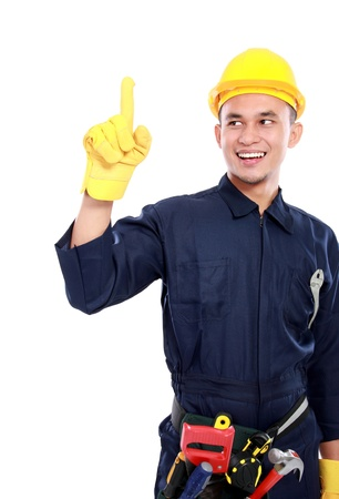 portrait of worker use blue uniform and belt tools and pointing upwards photo