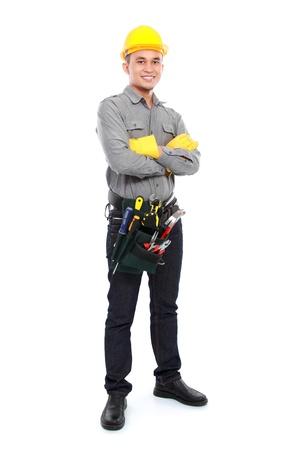 動作するように準備ができて完全な装置が笑みを浮かべて労働者の肖像画 写真素材