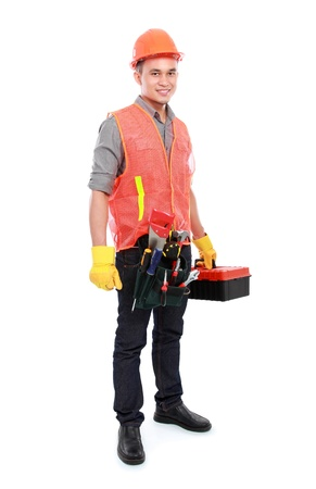 portrait of industrial worker bring equipment ready to work photo