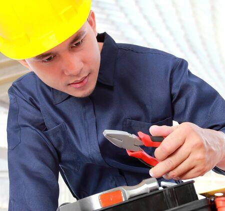 portrait worker check his equipment photo