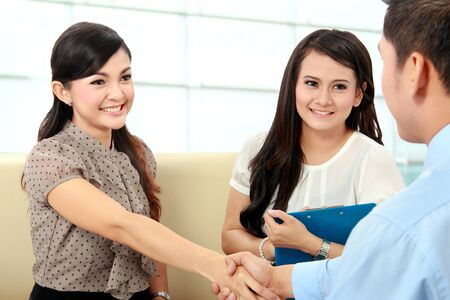 outsourcing: Portrait of successful business colleagues shaking hands after interview Stock Photo