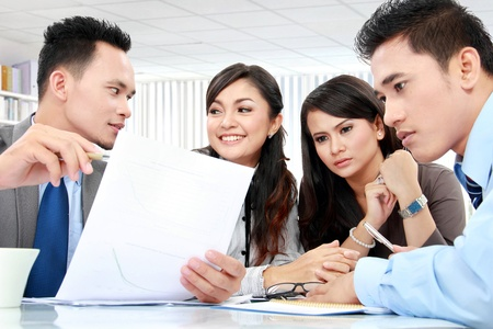 business man and woman meeting in the office with lot of paperworks photo
