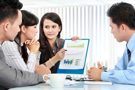 Portrait of successful business people having a discussion in the office Stock Photo - 17064823