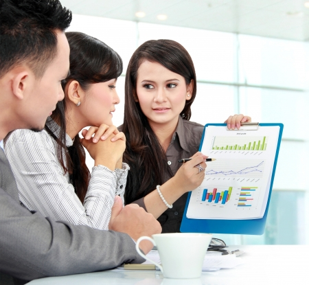 Portrait of successful business people discussing about company income Stock Photo - 17064726