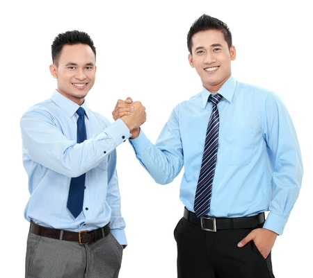 Portrait of two happy business men shaking hands isolated over white background photo
