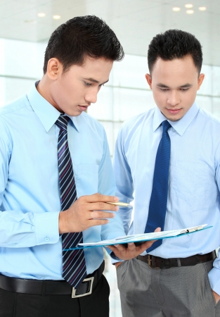 Two businessmen discussing a business chart growth Stock Photo - 17064822